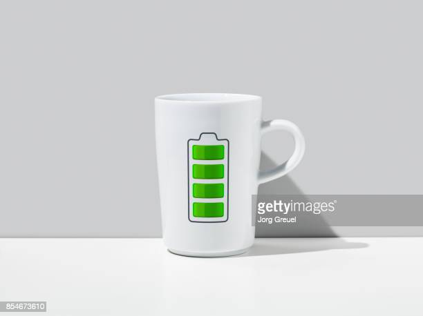 Battery charging icon on a coffee mug