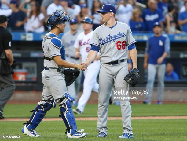 Battery mates Los Angeles Dodgers Catcher Austin Barnes and Los Angeles Dodgers Pitcher Edward Paredes shake hands after the final out of the...