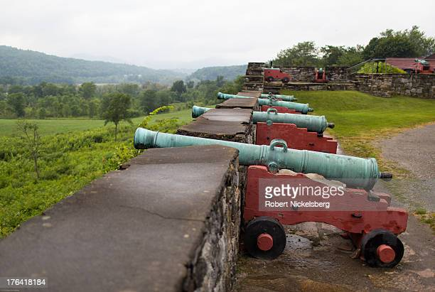 A battery of bronze cannons point out to Lake Champlain August 1 2013 at the restored Fort Ticonderoga in Ticonderoga New York The large 18thcentury...