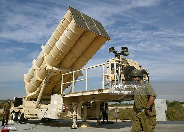 A battery of six Arrow missiles is raised into launch position at the Israeli Air Force's Palmahim base as the antiballistic missile system is put on...