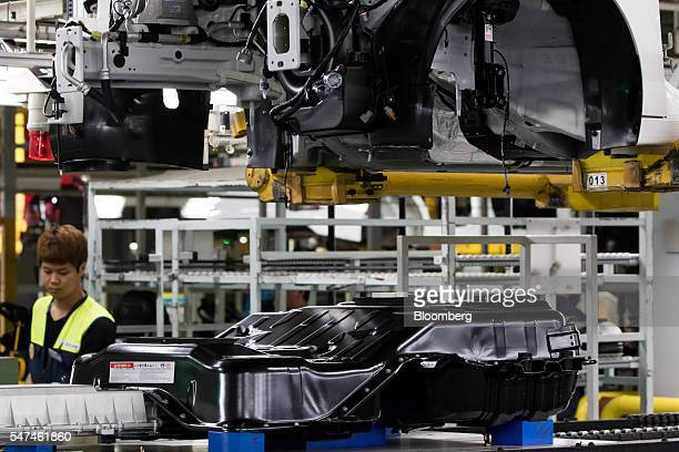 Battery pack for a Hyundai Motor Co. Ioniq electric vehicle , bottom, sits on the production line at the company's plant in Ulsan, South Korea, on...