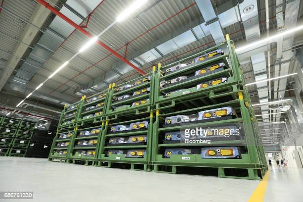 Battery packs for electric automobiles stand in racks ahead of shipping at the Deutsche Accumotive GmbH electric automobile battery factory operated...