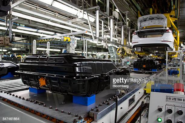 Battery packs for Hyundai Motor Co. Ioniq electric vehicles sit on the production line at the company's plant in Ulsan, South Korea, on Monday, July...