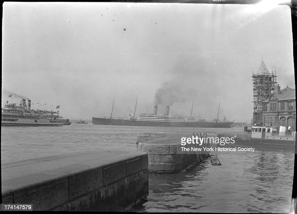 Battery Park and New York Harbor seawall steamships visible in harbor beyond New York New York late 19th or early 20th century