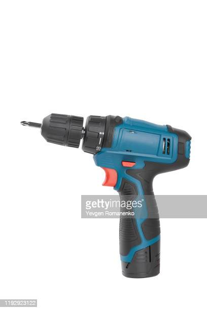 battery screwdriver or drill, isolated on white background - taladro fotografías e imágenes de stock