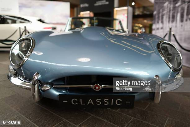 A battery version of Jaguar's iconic EType roadster automobile stands on display at the annual tech fair of Tata Motors Ltd's Jaguar Land Rover...