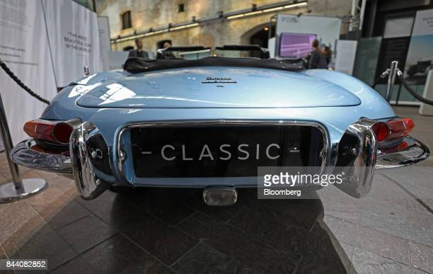 A battery versionof Jaguar's iconic EType roadster automobile stands on display at the annual tech fair of Tata Motors Ltd's Jaguar Land Rover...
