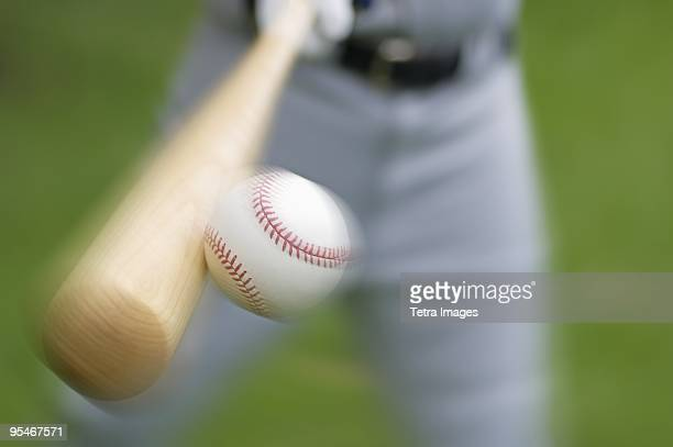 batting a baseball - baseball bat stock pictures, royalty-free photos & images