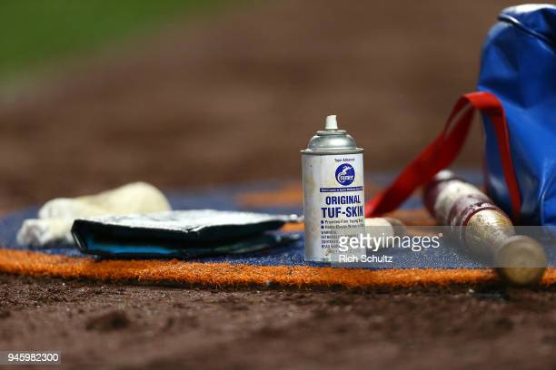 Batting accessories sit in the on deck circle during a game between the Philadelphia Phillies and New York Mets at Citi Field on April 3 2018 in the...