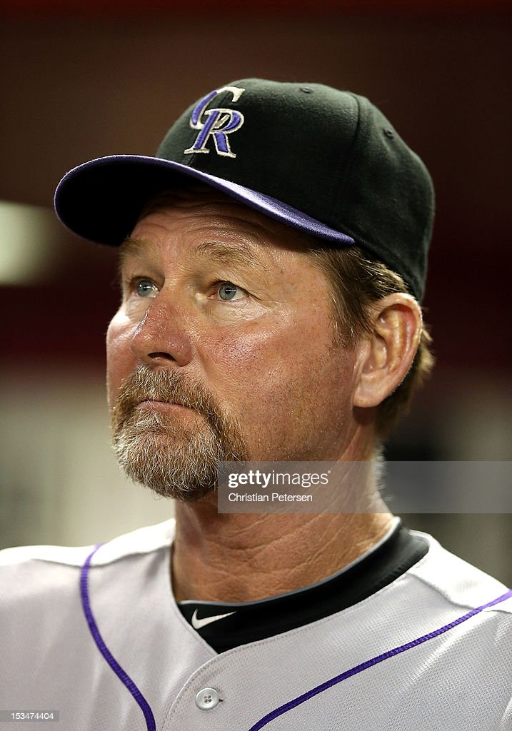 Batting coach Carney Lansford of the Colorado Rockies watches from the dugout during the MLB game against the Arizona Diamondbacks at Chase Field on October 2, 2012 in Phoenix, Arizona.