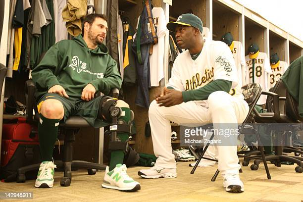 Batting Coach Chili Davis of the Oakland Athletics talks with Scott Sizemore in the clubhouse prior to the game against the Seattle Mariners at the...