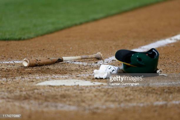 Batting equipment sits at home plate during the game between the Detroit Tigers and the Oakland Athletics at Ring Central Coliseum on September 06,...