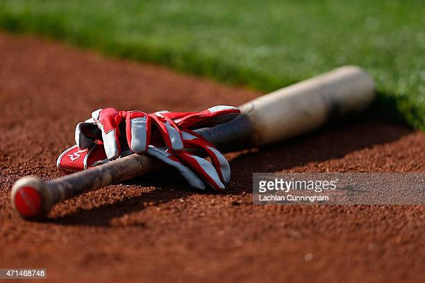 Batting gloves and a bat lay on the field before Los Angeles Angels of Anaheim v Oakland Athletics at Oco Coliseum on April 28 2015 in Oakland...