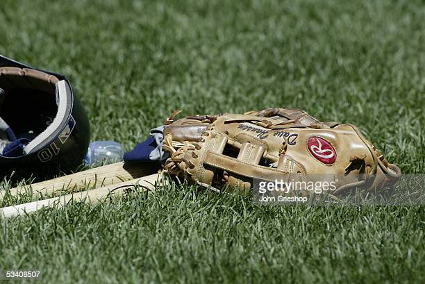 A batting helmet glove and two bats belonging to Dave Hansen of the Seattle Mariners before the game against the Cleveland Indians at Jacobs Field on...