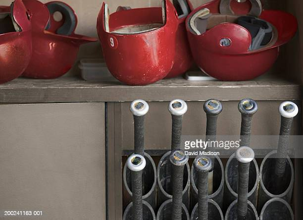 batting helmets and bats in baseball dugout - sports dugout stock pictures, royalty-free photos & images