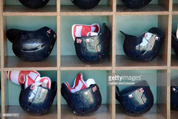 Batting helmets are seen in the dugout of the Boston Red Sox during the game against the Tampa Bay Rays at Fenway Park on April 17 2017 in Boston...