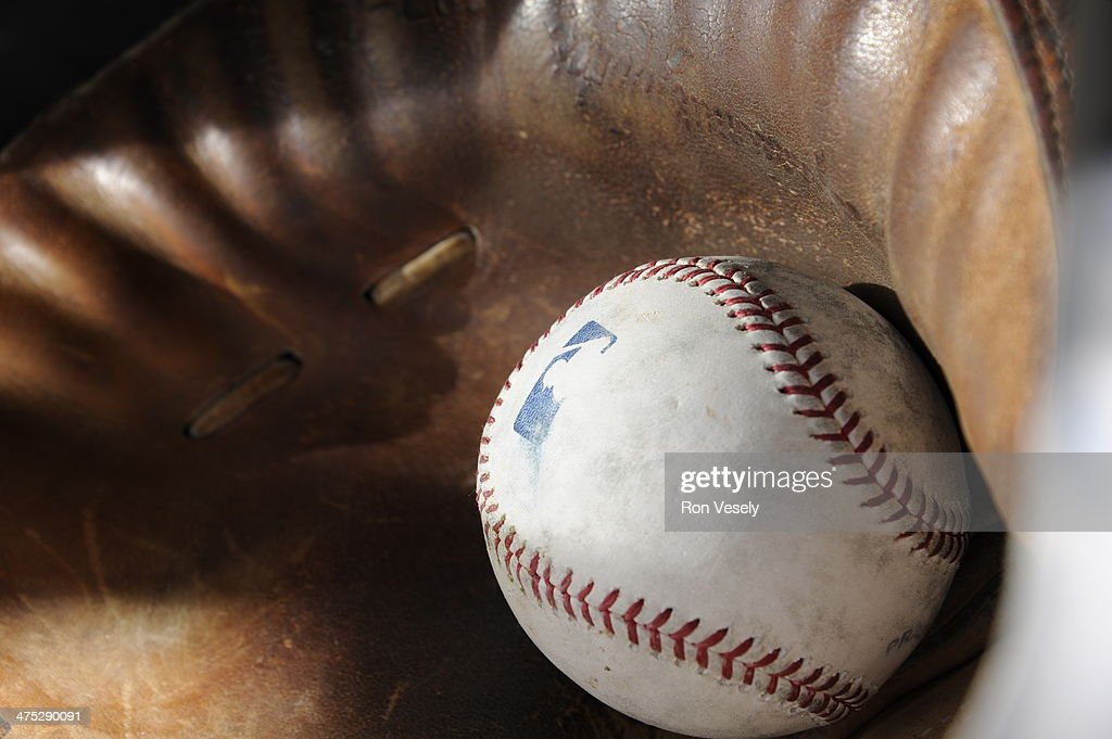 A batting practice baseball rests in a catchers mitt during Chicago White Sox spring training workouts on February 19, 2014 at The Ballpark at Camelback Ranch in Glendale, Arizona. (Photo by Ron Vesely/MLB Photos via Getty Images) ***