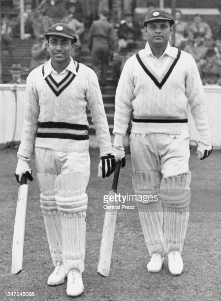 Batting tailenders Chandu Sarwate and Shute Banerjee of India walk to the wicket to continue their first innings for the touring Indian Cricket Team...