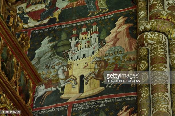 Battle between knights in front of a fortified city fresco in the Church of the Holy Spirit Dragomirna Monastery Mitocu Dragomirnei Bukovina Moldova...