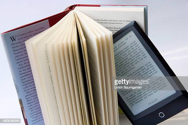 Battle for supremacy in the book market Our picture shows a bound book and between the sides an eBook on December 18 2014 in Bonn Germany