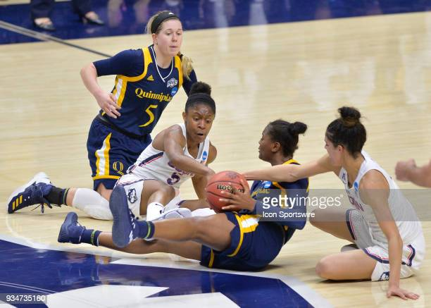 A battle for the ball ensues UConn Huskies Guard Crystal Dangerfield and UConn Huskies Guard Kia Nurse attempt to force a turnover from Quinnipiac...