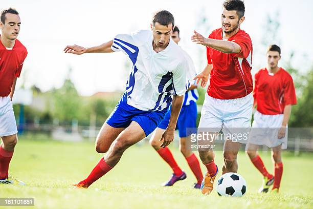 battle for the ball. - soccer team stock pictures, royalty-free photos & images