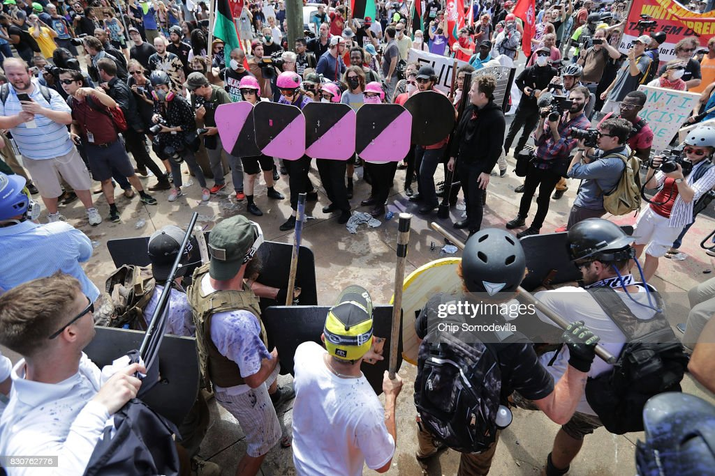 Battle lines form between white nationalists, neo-Nazis and members of the 'alt-right' and anti-fascist counter-protesters at the entrance to Emancipation Park during the 'Unite the Right' rally August 12, 2017 in Charlottesville, Virginia. After clashes with anti-fascist protesters and police the rally was declared an unlawful gathering and people were forced out of Emancipation Park, where a statue of Confederate General Robert E. Lee is slated to be removed.