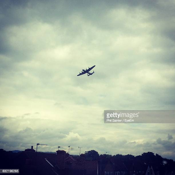 battle of britain flight against cloudy sky - battle of britain stock pictures, royalty-free photos & images