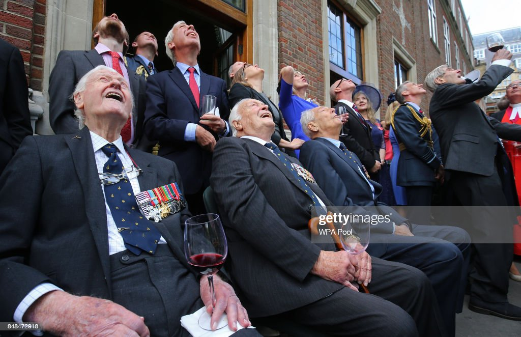 Battle of Britain veterans (L-R) Wing Commander Tom Neil, Squadron Leader Geoffrey Wellum, Wing Commander Tim Elkington and Wing Commander Paul Farnes watch a flypast following a service marking the 77th anniversary of the Battle of Britain at Westminster Abbey on September 17, 2017 in London, England. The annual service remembers the pilots and aircrew of the Royal Air Force who lost their lives in the 1940 Battle of Britain during World War II.