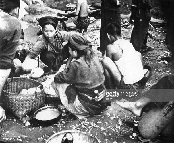 Battle of Dien Bien Phu1954 Conscripted labourers prepare rice balls water to serve the vietminh's soldiers fighting against the french forces