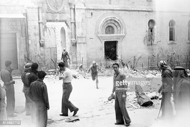 Battle of Jerusalem Jerusalem Palestine An Arab rifleman dashed from Notre Dame de France a church which overlooks the old walled city of Jerusalem...