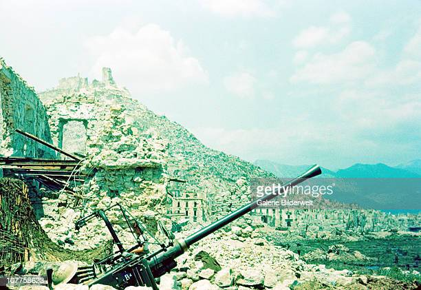 Battle Of Monte Cassino British soldiers are emplaced with a Bofors 40 mm antiaircraft gun below Monte Cassino April 1944 The monastery has already...