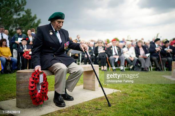 Battle of Monte Cassino veteran Bryan Woolnough, aged 96, prepares to lay a wreath at the Battle of Monte Cassino memorial during a commemorative...