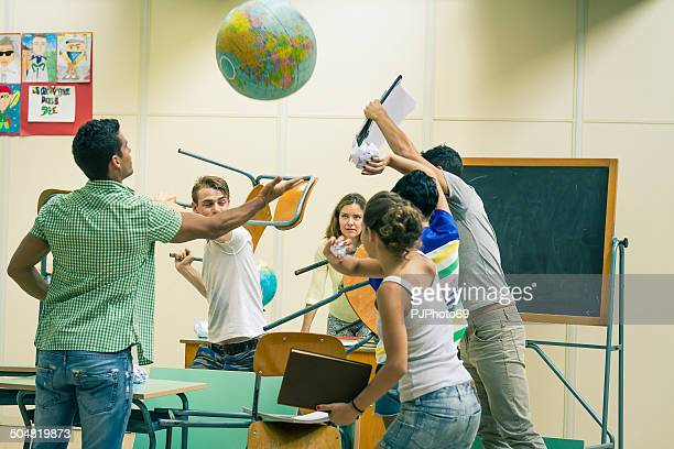 battle of students in classroom - violence stock photos and pictures