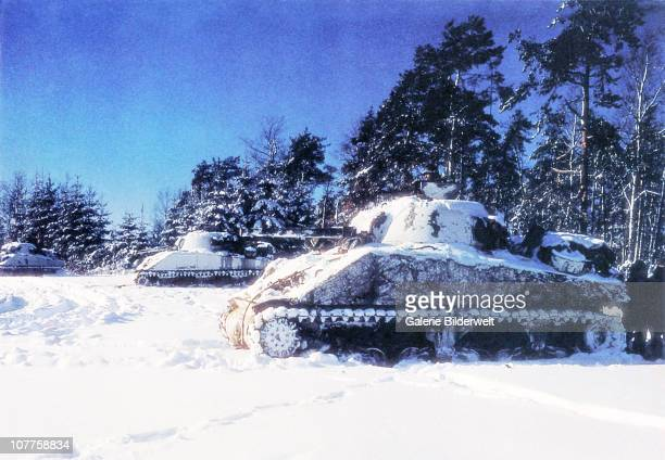 Battle of the Bulge Three M4 Sherman tanks have taken up positions near St Vith during the Battle of the Bulge also known as the Ardennes Offensive...