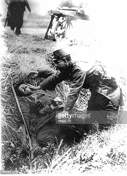 Soldier helping a casualty World War I