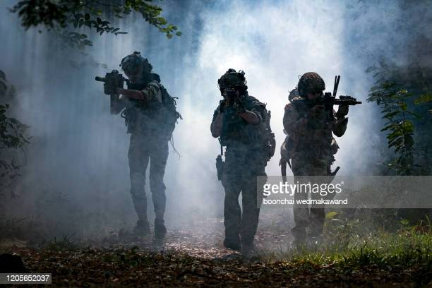 battle of the military in the war. military troops in the smoke - terrorism stock pictures, royalty-free photos & images