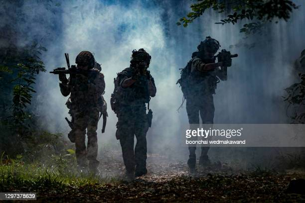 battle of the military in the war. military troops in the smoke - war and conflict stock pictures, royalty-free photos & images