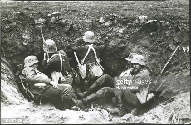 Battle of Ypres, Five men manning a shell. Sentry and observerty the other three resting, Ypres.