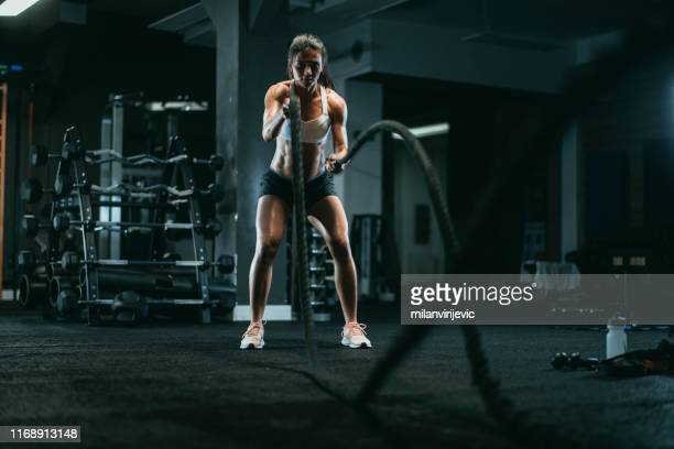 battle rope workout on cross training - battle stock pictures, royalty-free photos & images