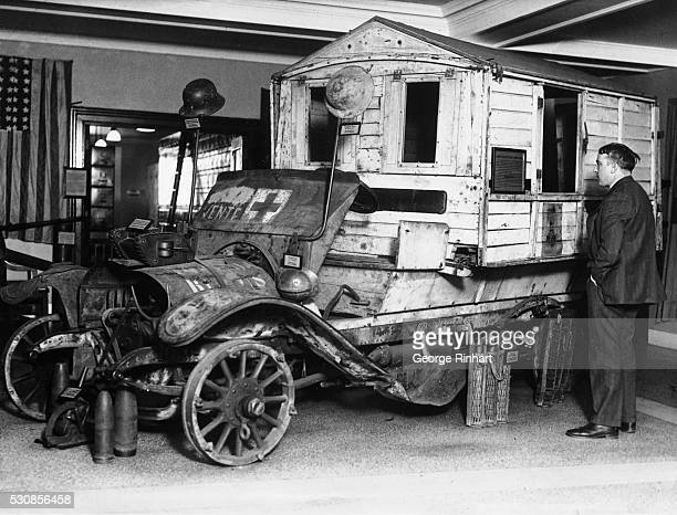 A battle scarred ambulance wearing a Croix de Guerre with three stars is one of the most striking relics of the world war standing on permanent...