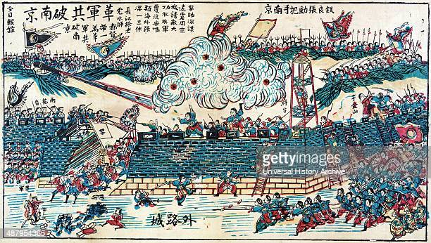 Battle scene showing Japanese soldiers storming a Chinese fort engaging troops who are defending the fort Japanese woodcut dated between 1895 and...