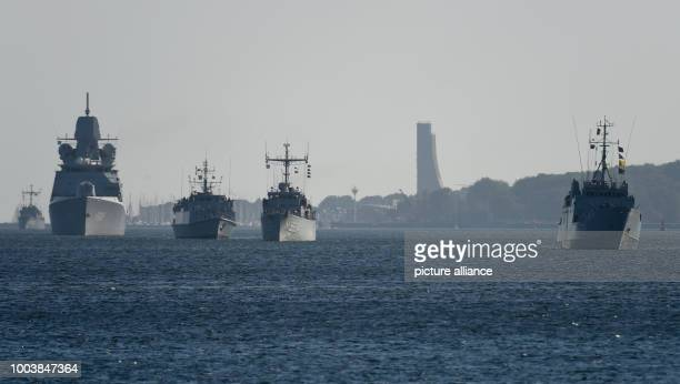 Battle ships enter the port at the navy harbour in Kiel Germany 16 June 2017 More than 40 navy ships from 13 nations will lie at anchor here during...