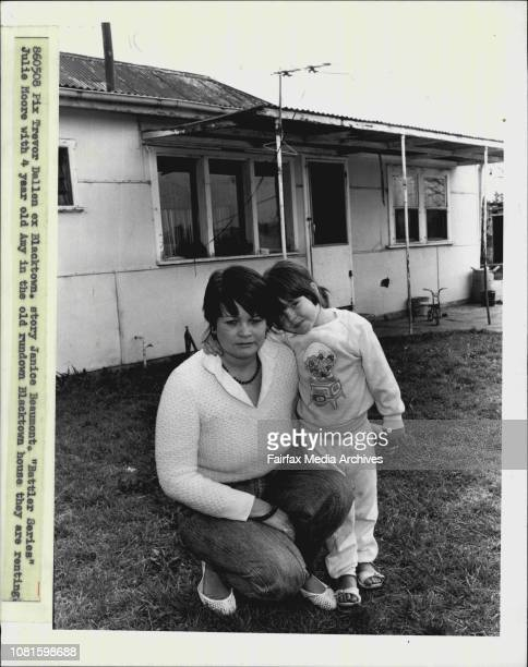 Battler Series' Julie Moore with 4 year old Amy in the old rundown Blacktown house they are rentingIt's 10 years since Julie Moore has been to a...
