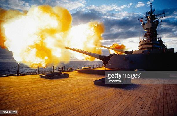 battleship firing guns - military ship stock pictures, royalty-free photos & images