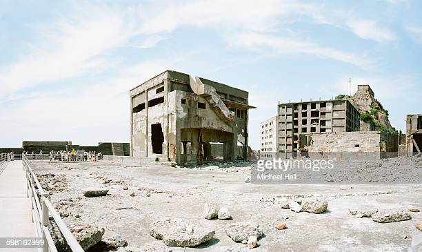 battleship island - gunkanjima - abandoned stock pictures, royalty-free photos & images