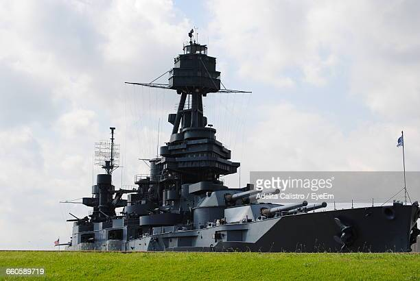 Battleship On Field Against Sky