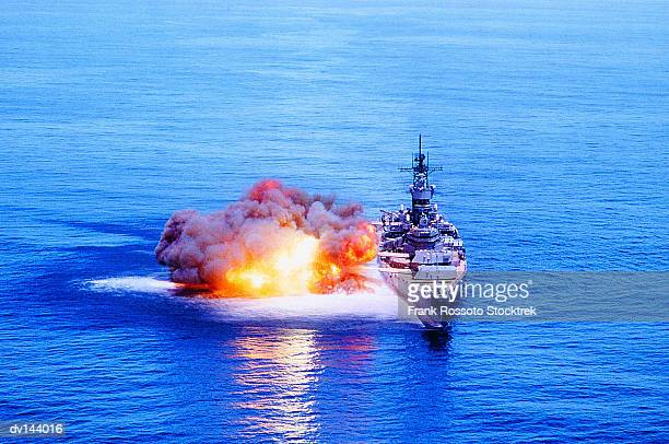 Battleship USS Iowa (BB-61) firing guns