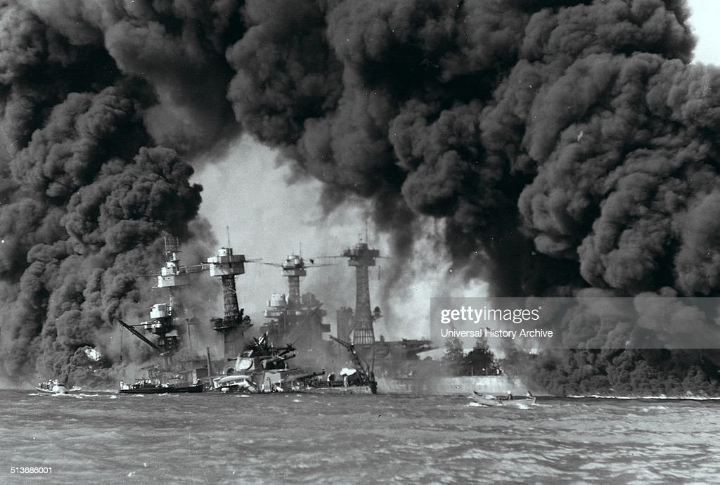 Battleships burning after the attack on Pearl Harbour. : News Photo