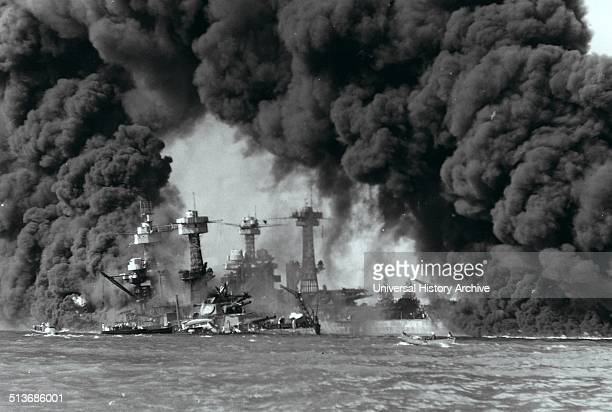 Battleships West Virginia and Tennessee burning after the Japanese attack on Pearl Harbor, 7th December 1941.